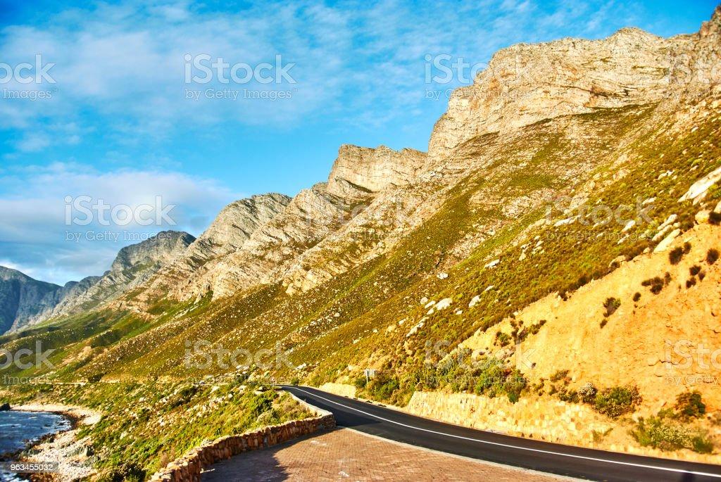 Route du bord de mer au coucher du soleil Boland montagne complexe, Western Cape - Photo de Afrique libre de droits