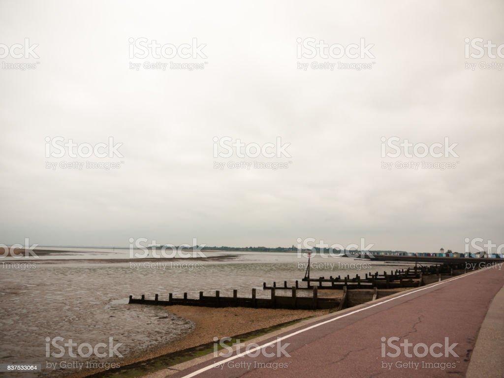 seaside scene overcast mudflats walkpath trail gryones stock photo