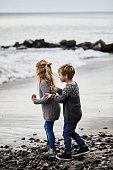 Brother and sister on beach playing