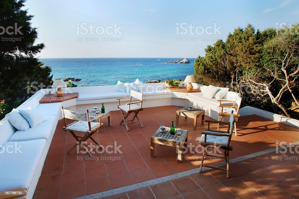 Seaside terracotta terrace surrounded by trees, sea on background stock photo