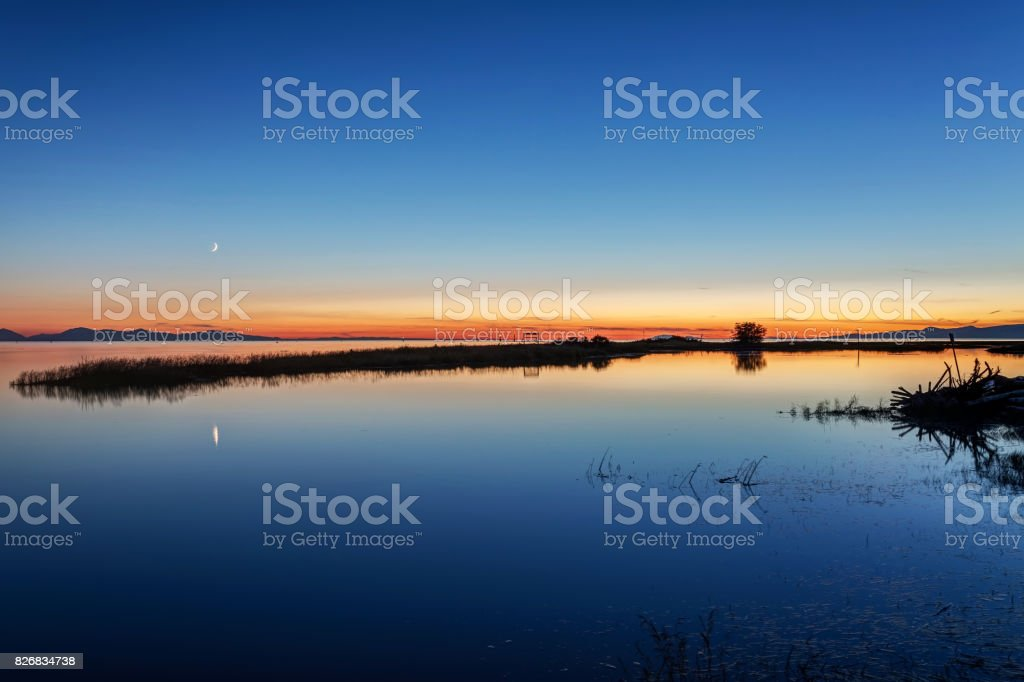 seaside view at blue hour after sunset stock photo