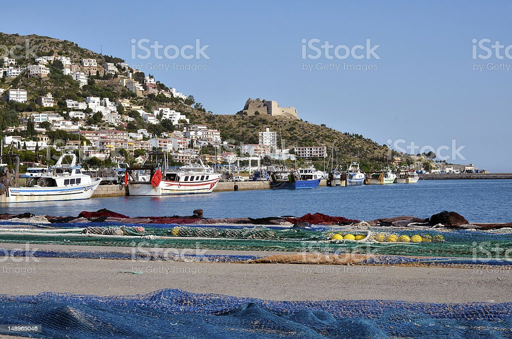 Seaside view from port of Roses town in Spain on sunny day stock photo