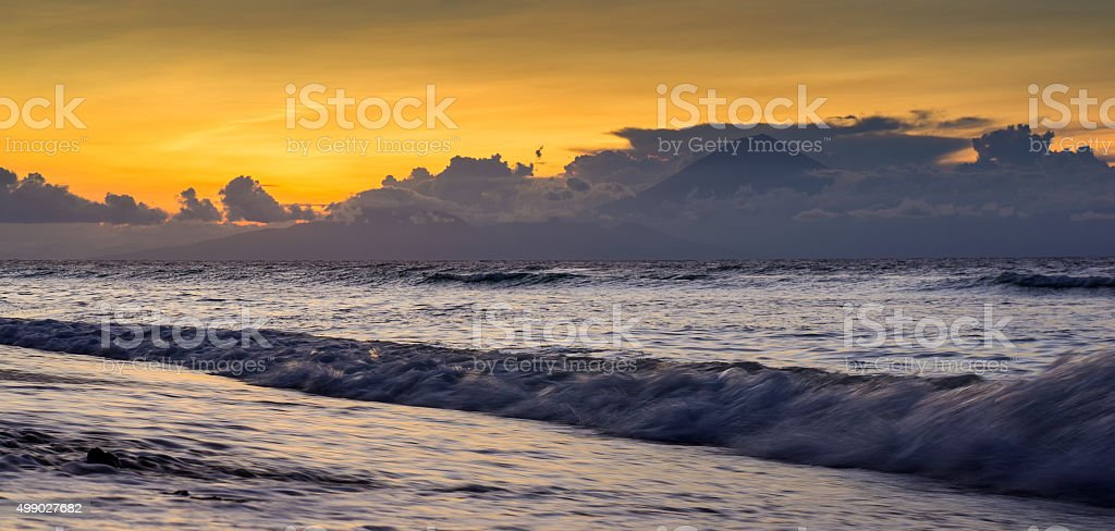 Seaside with Volcano on a background, Bali, Indonesia. stock photo