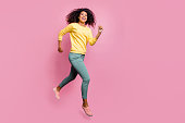 Season of discount concept. Full length body size photo of excited optimistic lucky carefree, expressing hipster teenager jumping up in hurry to get best getaway wear casual clothes isolated background