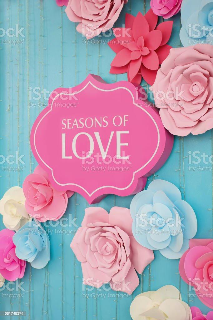 Season of love text on pink signboard stock photo