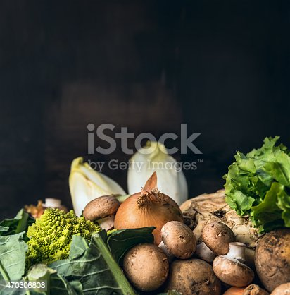 season vegetables for cooking over dark background