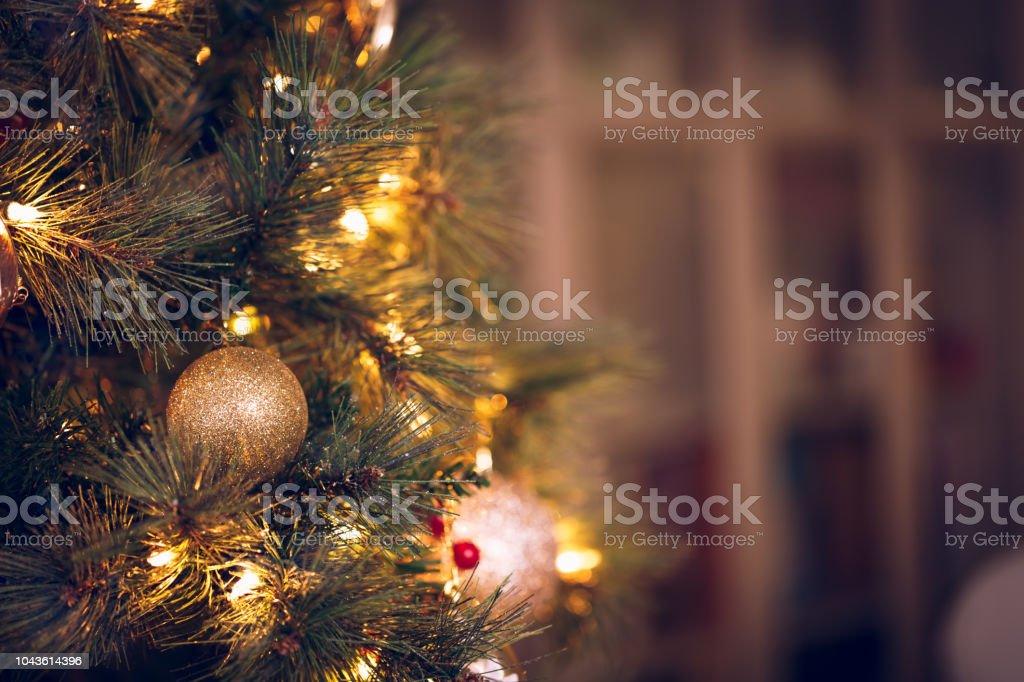 Seasonal background with Christmas toys on the tree. Celebration...