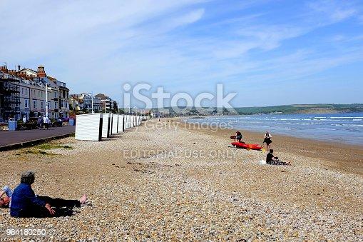 istock Seasonal beach huts, Weymouth, Dorset, UK. 964180250