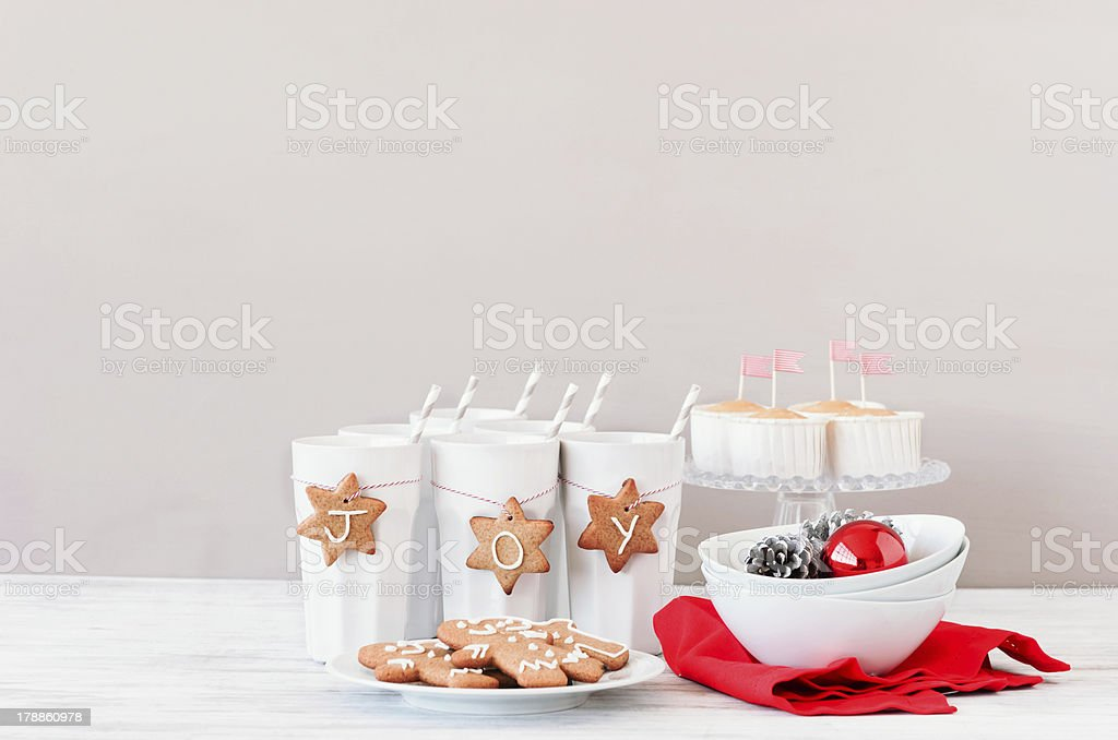 Seasonal christmas table decoration using gingerbread man and st royalty-free stock photo