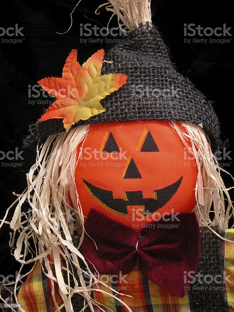 Seasonal: Fall Colored Pumpkin Head Scarecrow royalty-free stock photo