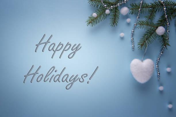tarjeta de felicitación de temporada con letrero feliz navidad - happy holidays fotografías e imágenes de stock