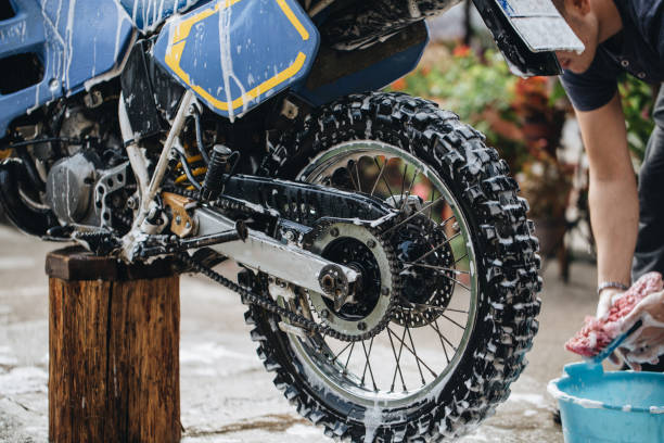 Seasonal maintenance of a motorcycle stock photo