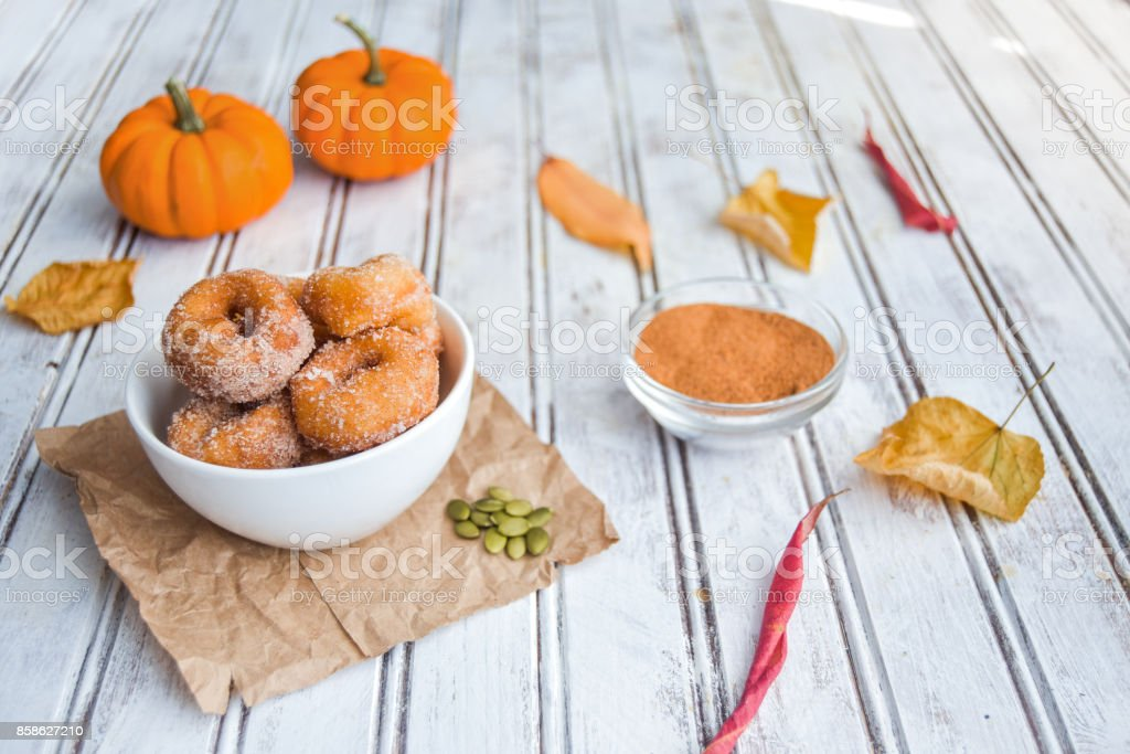 Seasonal Pumpkin Spice Donuts on White Table stock photo