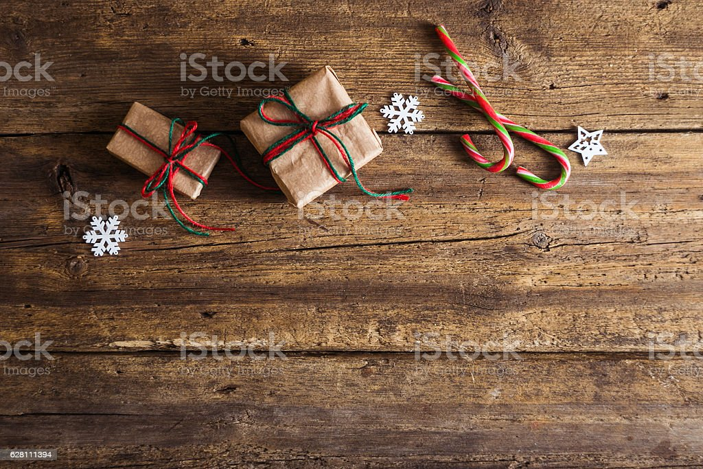 Seasonal Rustic Christmas Border Composed Of Decorative Gifts Royalty Free Stock Photo
