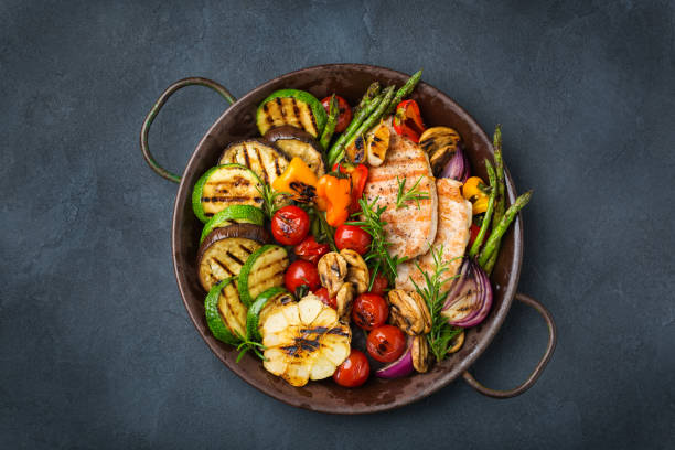 Seasonal summer grilled vegetables and chicken breast stock photo