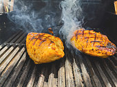 istock Seasoned BBQ Chicken Breast Outdoor Grilled Food Western Colorado Cooking Photo Series 1326022258