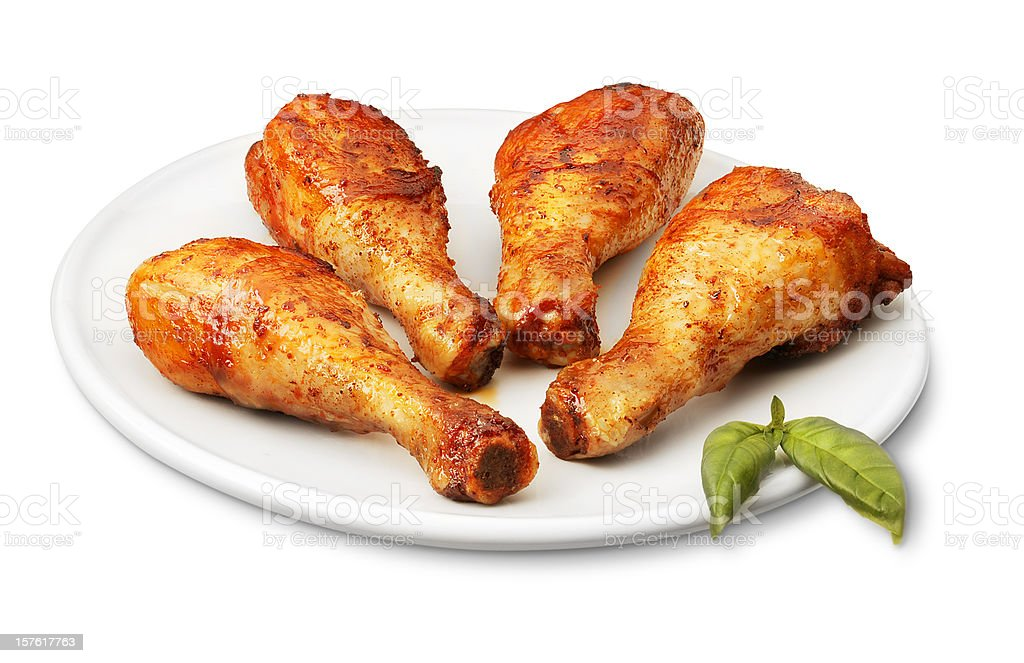 Seasoned chicken legs on a white dish royalty-free stock photo
