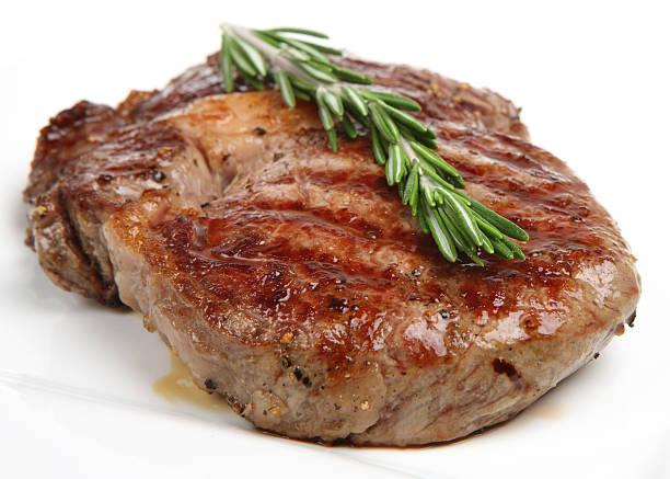 seasoned & cooked rib-eye steak - ribeye biefstuk stockfoto's en -beelden