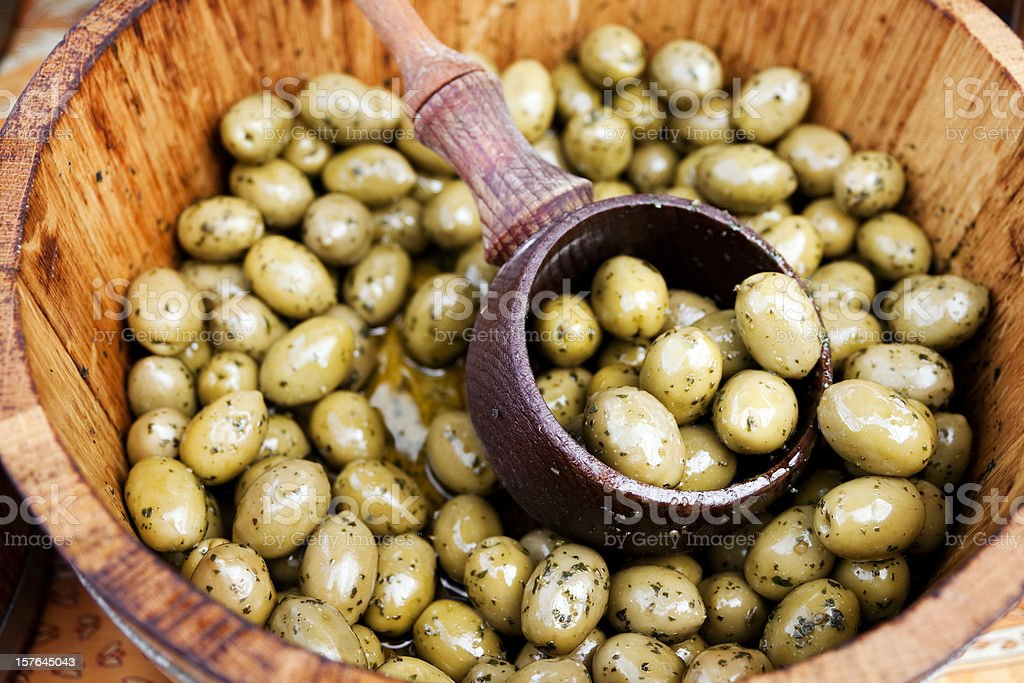 Seasoned green olives in a tub royalty-free stock photo