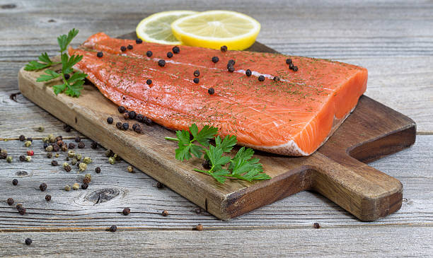 seasoned salmon fillet on rustic wood - chinook salmon stock photos and pictures