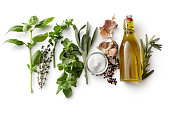 Seasoning: Fresh Herbs, Olive Oil, Garlic, Salt and Pepper Isolated on White Background