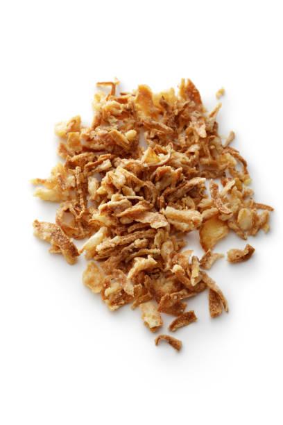 seasoning: fried onions isolated on white background - estaladiço imagens e fotografias de stock