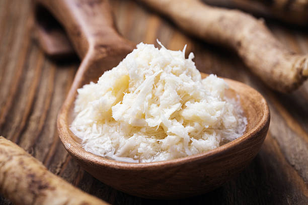 Seasoning of grated horseradish, closeup Seasoning of grated horseradish, closeup horseradish stock pictures, royalty-free photos & images