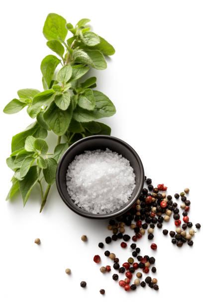 Seasoning: Salt, Oregano and Pepper Isolated on White Background stock photo