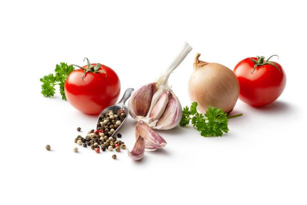 Seasoning: Tomato, Garlic, Onion, Parsley and Peppercorns Isolated on White Background stock photo