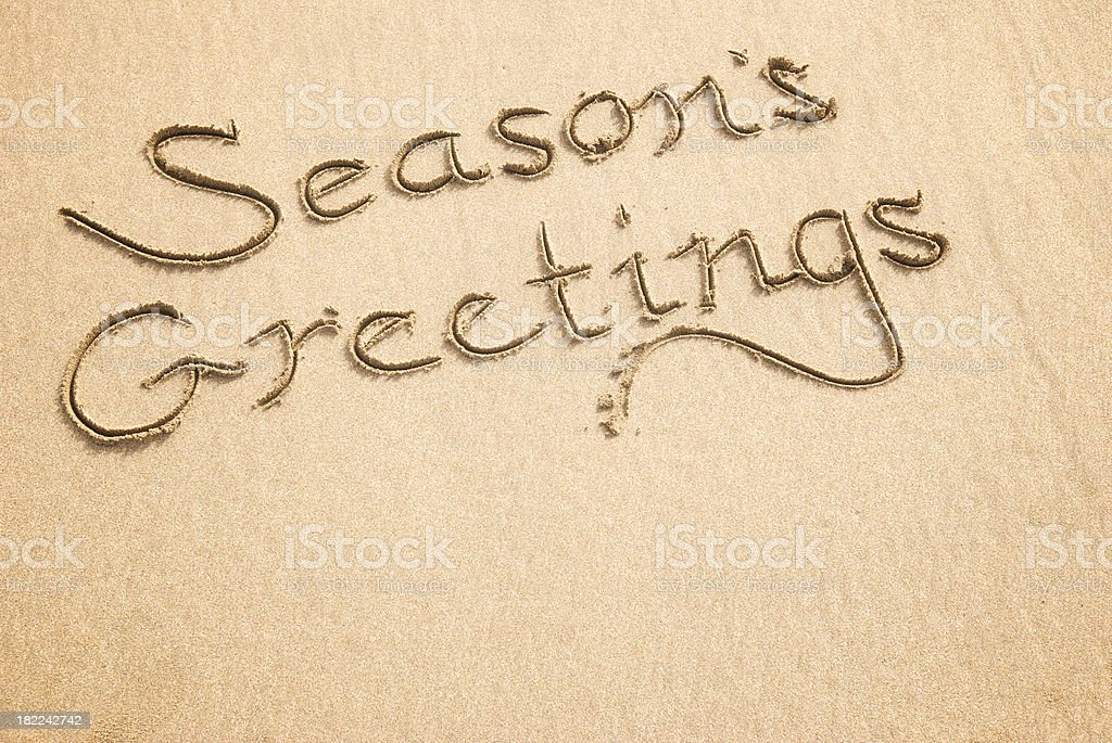 Season's Greetings Calligraphy Message in Sand stock photo