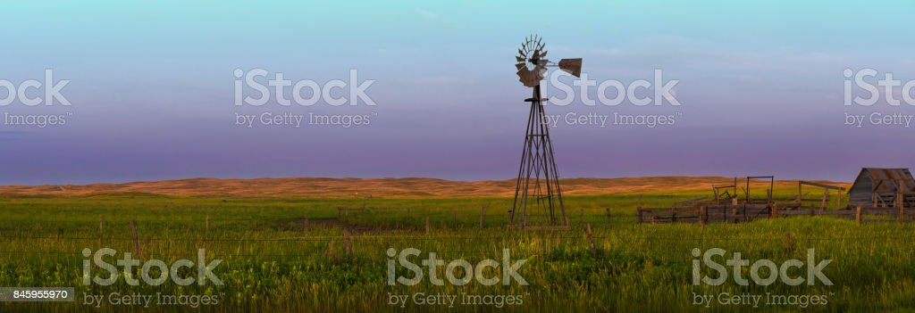 4 Seasons Western Nebraska Sand Hills Landscape With Windmill stock photo