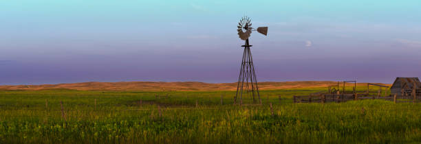 4 seasons western nebraska sand hills landscape with windmill - great plains stock photos and pictures
