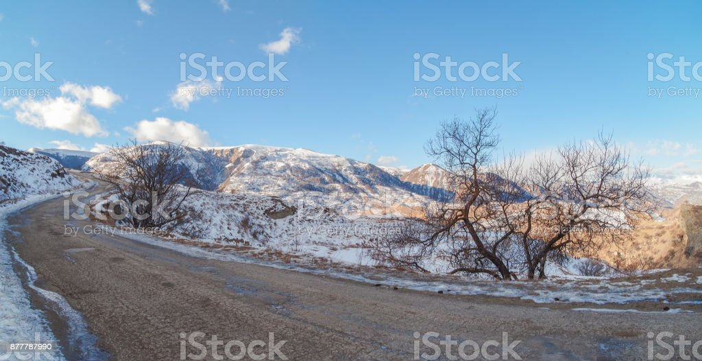 4 Seasons. Winter road in mountains. Empty road. Nature and travel. Russia, Dagestan stock photo