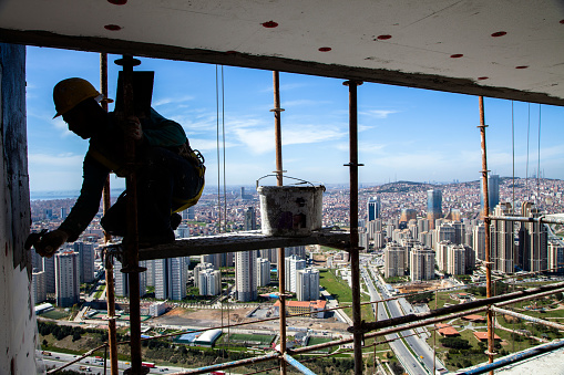 Seat belt not fastened when construction worker is working in an elevated place,Istanbul,Turkey.2 April 2013