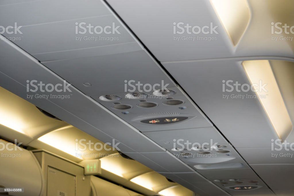 seat belt sign and non-smoking sign with air conditioner stock photo