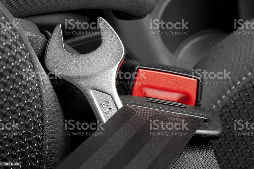 Seat belt with wrench royalty-free stock photo
