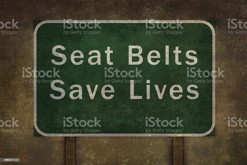 'Seat belts save lives' roadside sign illustration stock photo
