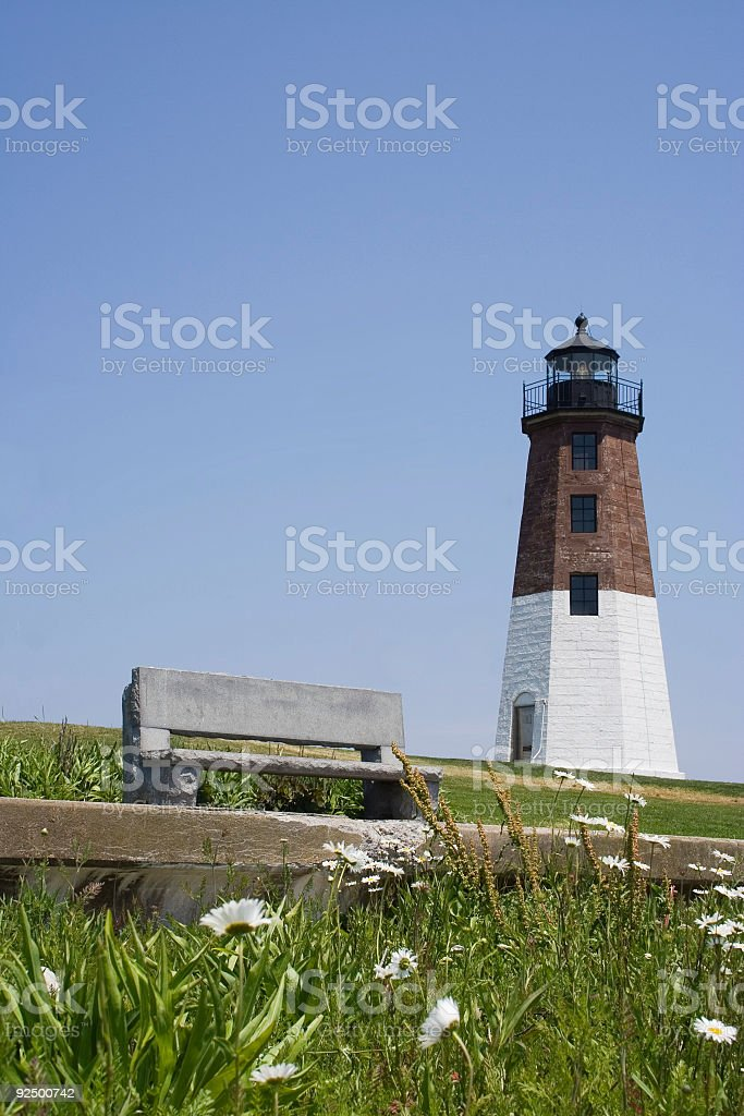 Seat, flowers and lighthouse royalty-free stock photo