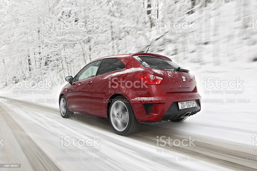 Seat Ibiza Bocanegra driving on a snowy road royalty-free stock photo