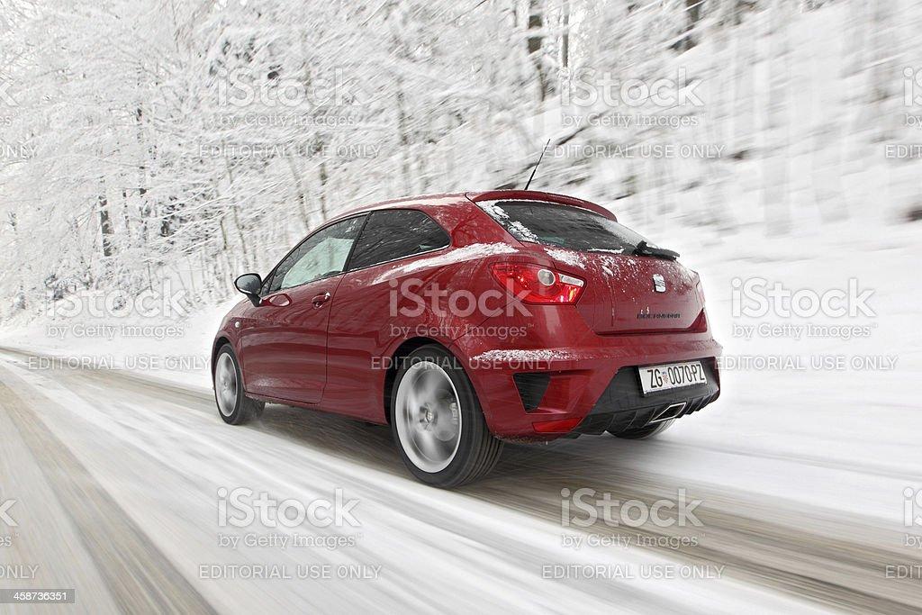 Seat Ibiza Bocanegra driving on a snowy road stock photo