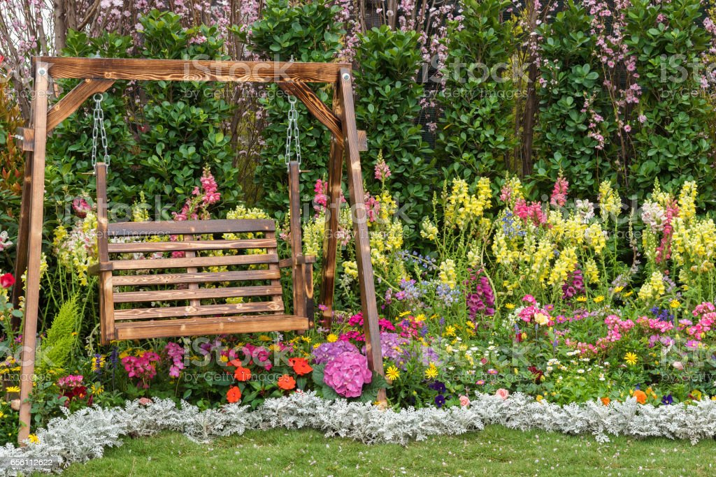 seat in flower garden stock photo
