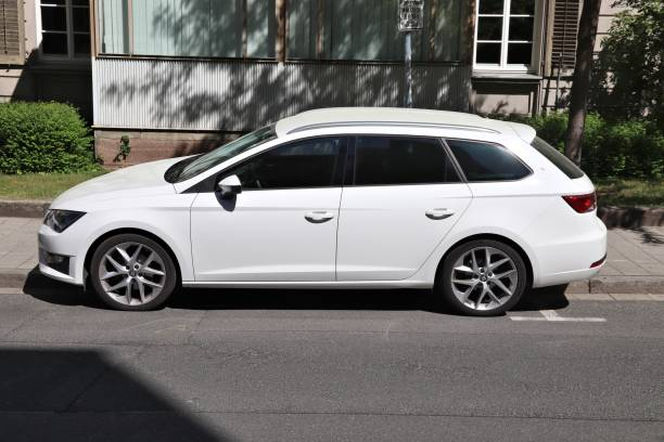 Seat Leon estate White Seat Leon station wagon car parked in Germany. There were 45.8 million cars registered in Germany (as of 2017). erlangen stock pictures, royalty-free photos & images
