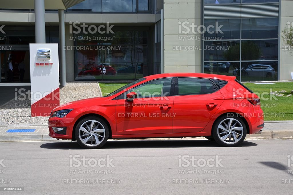 Seat Leon stopped near the entry to the Seat office stock photo