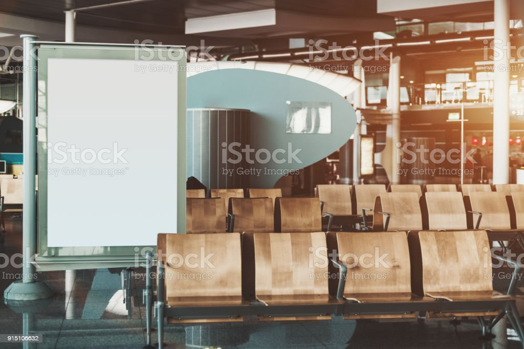 Seat rows in airport with mock-up of informational banner stock photo