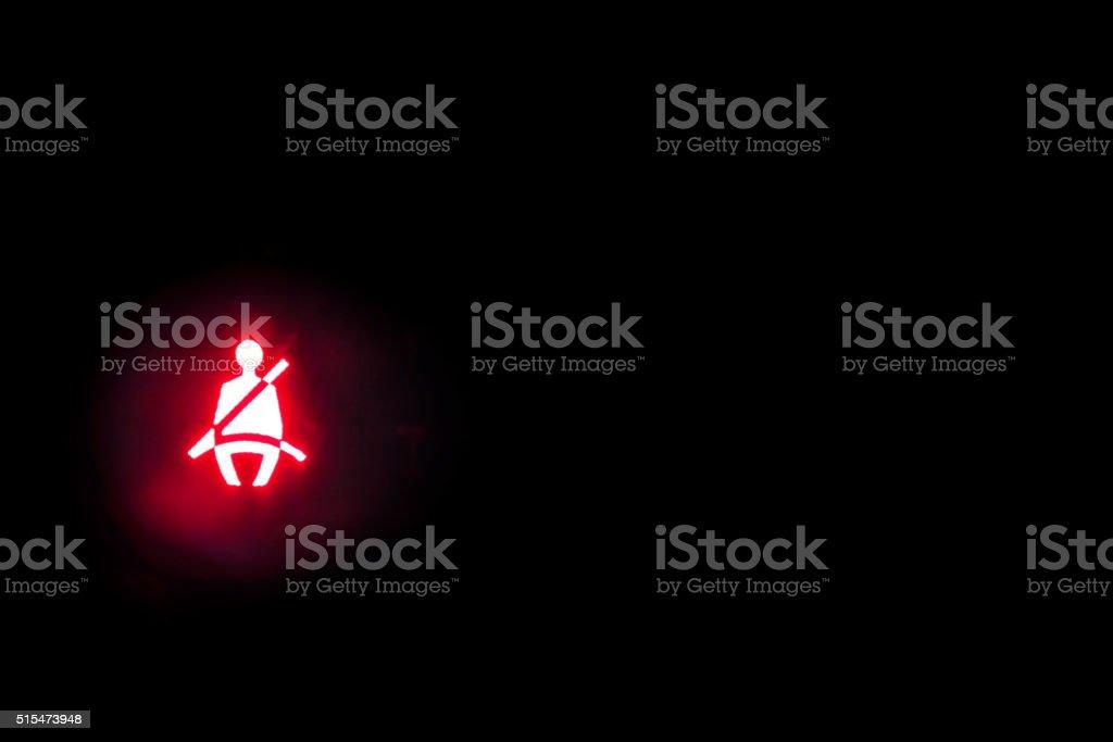 Seatbelt light showing on the black background stock photo