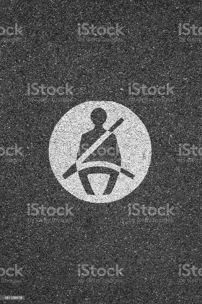 Seatbelt sign on asphalt stock photo