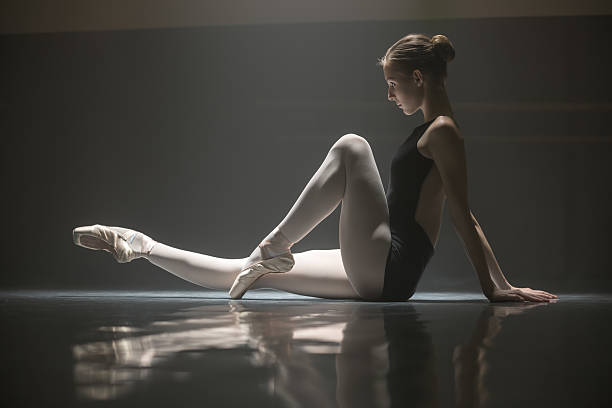 Seated ballerina in class room stock photo