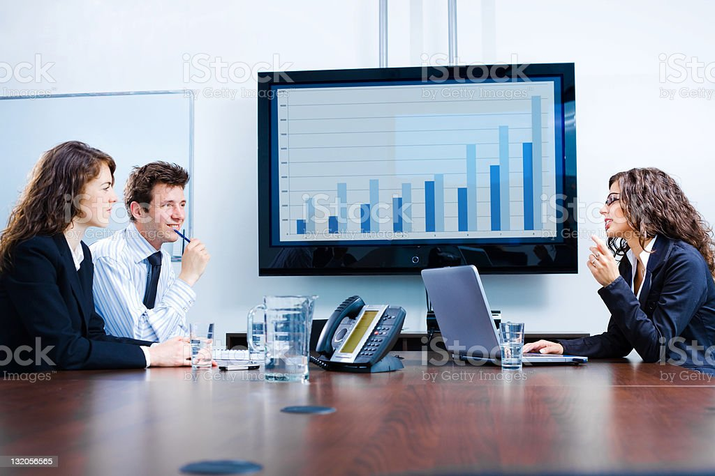 Seated businesspeople discussing in meeting room stock photo