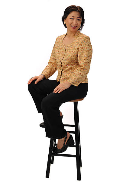 Seated Chinese businesswoman  stool stock pictures, royalty-free photos & images