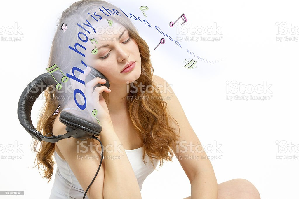 Seated girl contemplates about audio stock photo